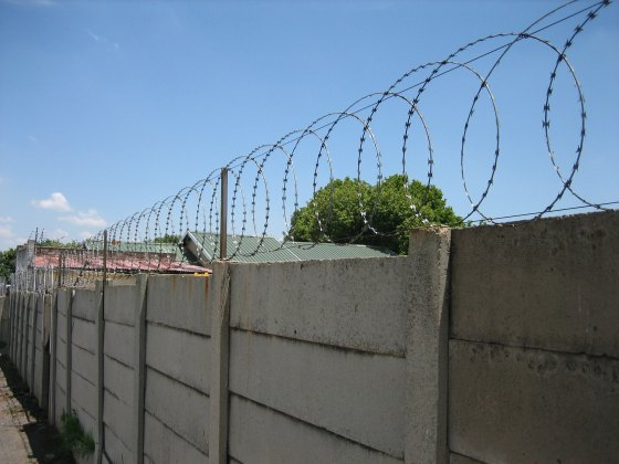 Large fence with razor wire in Johannesburg, South Africa